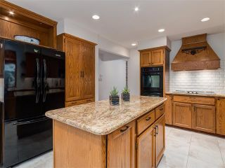 Photo 9: 308 COACH GROVE Place SW in Calgary: Coach Hill House for sale : MLS®# C4064754