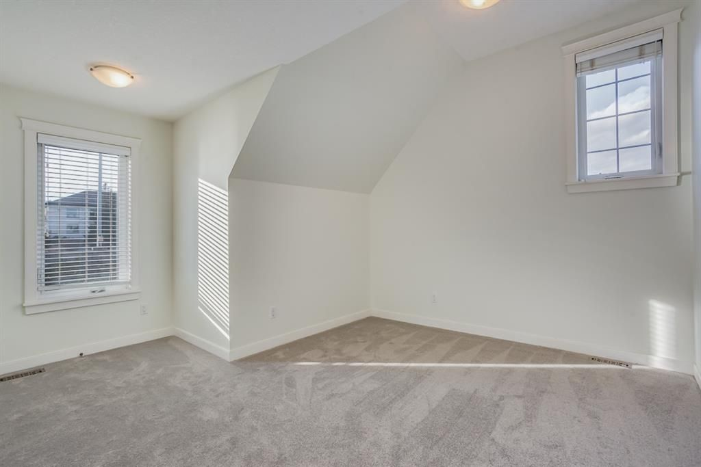 Photo 23: Photos: 219 Somme Manor SW in Calgary: Garrison Woods Detached for sale : MLS®# A1041747