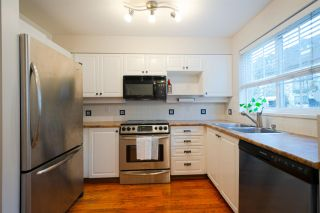 """Photo 1: 24 1561 BOOTH Avenue in Coquitlam: Maillardville Townhouse for sale in """"COURCELLES"""" : MLS®# R2319690"""