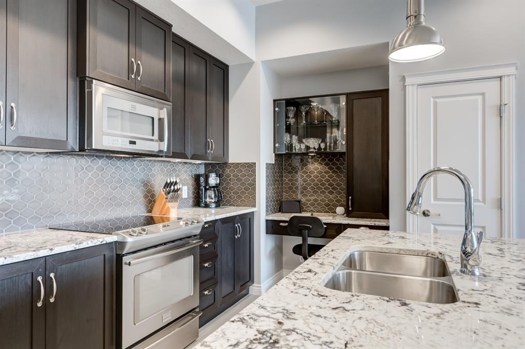 Photo 7: Photos: 312 39 Quarry Gate SE in Calgary: Douglasdale/Glen Apartment for sale : MLS®# A1103022