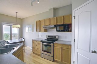 Photo 15: 106 Hamptons Link NW in Calgary: Hamptons Row/Townhouse for sale : MLS®# A1117431