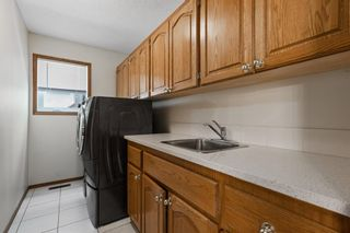 Photo 17: 927 Shawnee Drive SW in Calgary: Shawnee Slopes Detached for sale : MLS®# A1123376