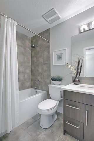 Photo 35: 444 Quarry Way SE in Calgary: Douglasdale/Glen Row/Townhouse for sale : MLS®# A1094767