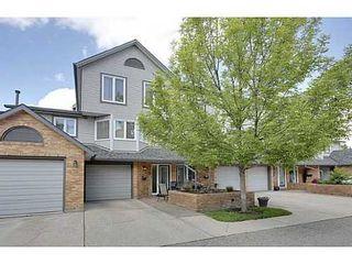 Photo 1: 22 COACHWAY Green SW in Calgary: 4 Level Split for sale : MLS®# C3572923