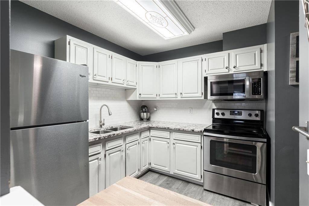 Photo 7: Photos: 1007 2520 PALLISER DR SW in Calgary: Oakridge Row/Townhouse for sale : MLS®# C4297041