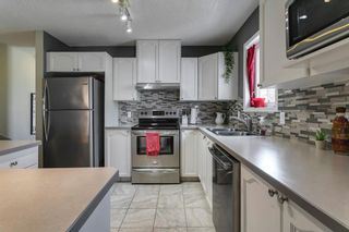 Photo 12: 1905 7171 COACH HILL Road SW in Calgary: Coach Hill Row/Townhouse for sale : MLS®# A1111553