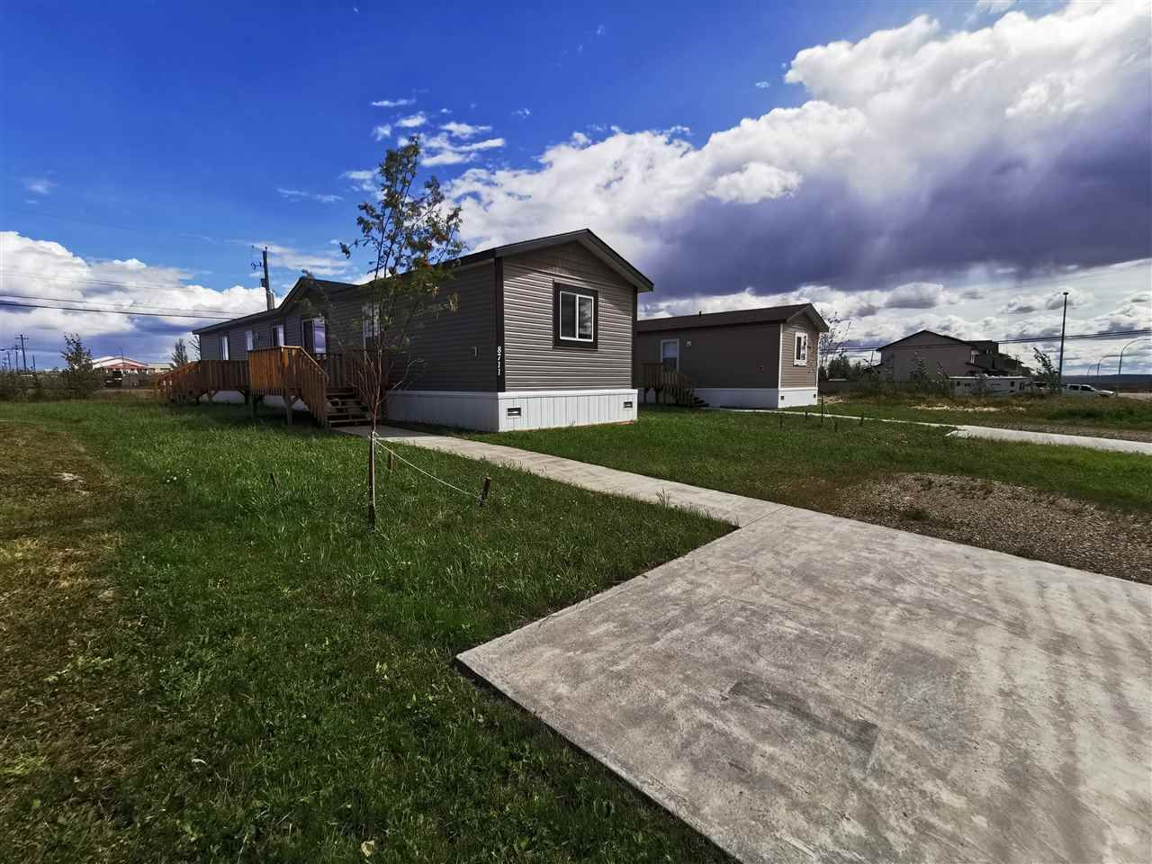 "Main Photo: 8711 74 Street in Fort St. John: Fort St. John - City SE Manufactured Home for sale in ""SOUTH ANNOEFIELD"" (Fort St. John (Zone 60))  : MLS®# R2553301"