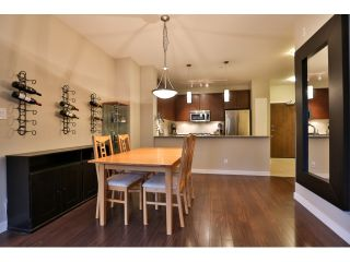 "Photo 4: 112 101 MORRISSEY Road in Port Moody: Port Moody Centre Condo for sale in ""LIBRA AT SUTER BROOK VILALGE"" : MLS®# R2010522"