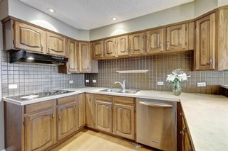 Photo 11: 607 Stratton Terrace SW in Calgary: Strathcona Park Row/Townhouse for sale : MLS®# A1065439