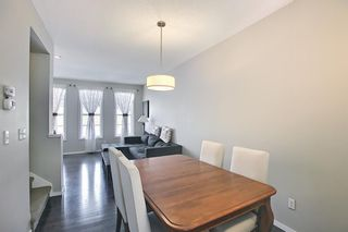 Photo 6: 314 Ascot Circle SW in Calgary: Aspen Woods Row/Townhouse for sale : MLS®# A1111264