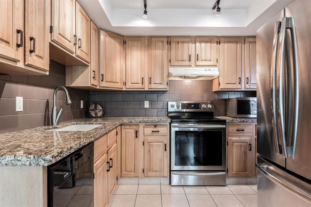 Photo 22: Photos: 84 WOODBROOK Close SW in Calgary: Woodbine Detached for sale : MLS®# A1037845