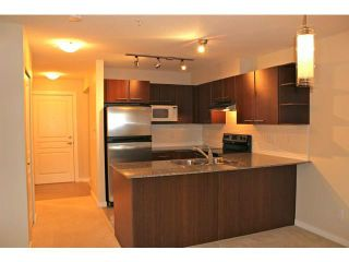 """Photo 1: 114 4728 BRENTWOOD Drive in Burnaby: Brentwood Park Condo for sale in """"VARLEY"""" (Burnaby North)  : MLS®# V995826"""