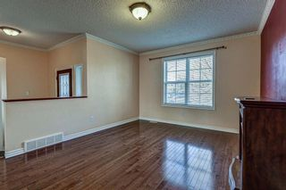 Photo 4: 64 Eversyde Circle SW in Calgary: Evergreen Detached for sale : MLS®# A1090737