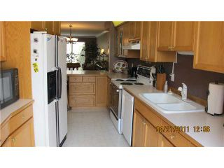 Photo 3: 9 323 GOVERNORS Court in New Westminster: Fraserview NW Townhouse for sale : MLS®# V884941