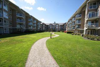 """Photo 1: 205 5880 DOVER Crescent in Richmond: Riverdale RI Condo for sale in """"WATERSIDE"""" : MLS®# R2068298"""
