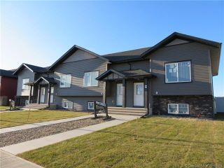 Main Photo: 62,66,70,74 Mackenzie Ranch Way in Lacombe: Mackenzie Ranch Estates Multi-Family for sale : MLS®# CA0180373
