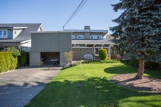 Photo 1: 12251 AGAR Street in Surrey: Crescent Bch Ocean Pk. House for sale (South Surrey White Rock)  : MLS®# R2568881
