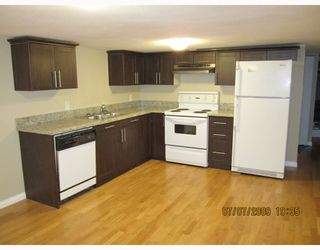 Photo 4: 7696 DAVIES Street in Burnaby: Edmonds BE House for sale (Burnaby East)  : MLS®# V775727