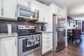 Photo 7: 440 Auburn Bay Avenue SE in Calgary: Auburn Bay Semi Detached for sale : MLS®# A1092990
