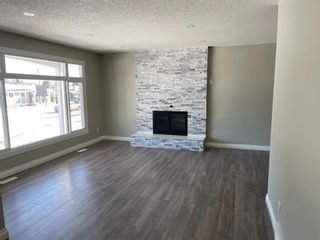 Photo 2: 127 MADDOCK Way NE in Calgary: Marlborough Park Detached for sale : MLS®# A1072674