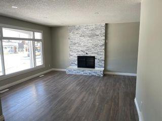 Photo 2: 127 MADDOCK Way NE in Calgary: Marlborough Park Detached for sale : MLS®# A1072674