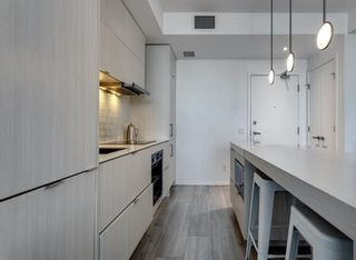 Photo 2: 908 615 6 Avenue SE in Calgary: Downtown East Village Apartment for sale : MLS®# A1086448