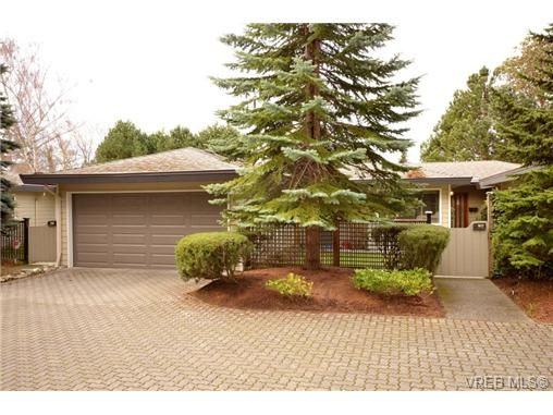 Double garage with private gated entrance and lawn.