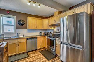 Photo 8: 25 200 HIDDEN HILLS Terrace in Calgary: Hidden Valley Row/Townhouse for sale : MLS®# A1022696