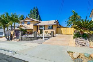 Photo 2: SAN CARLOS House for sale : 4 bedrooms : 7151 Regner Rd in San Diego