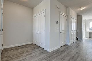 Photo 2: 132 Creekside Drive SW in Calgary: C-168 Semi Detached for sale : MLS®# A1098272