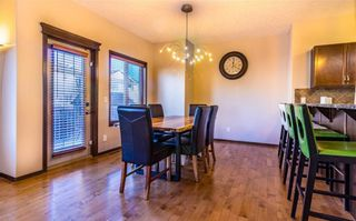 Photo 7: 30 WEST POINTE Manor: Cochrane House for sale : MLS®# C4150247