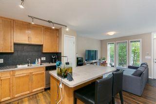 Photo 6: 218 Auburn Bay Square SE in Calgary: Auburn Bay Row/Townhouse for sale : MLS®# A1141951