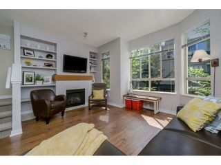 Photo 2: 64 100 KLAHANIE Drive in Port Moody: Port Moody Centre Townhouse for sale : MLS®# R2197843