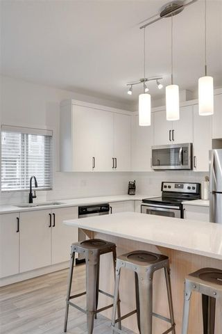 Photo 7: 416 LEGACY Point SE in Calgary: Legacy Row/Townhouse for sale : MLS®# A1062211