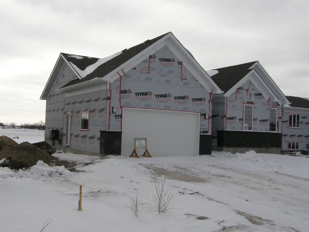 IMPRESSIVE New 1580 sf 3 Bedroom Bungalow with 9? ceilings, Full Basement, Town Sewer & Water, on a 75 x 173? lot in the Town of Garson. Blanket New Home Warranty.