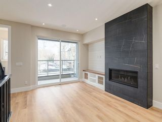Photo 9: 415 7 Street NW in Calgary: Sunnyside Row/Townhouse for sale : MLS®# A1062730