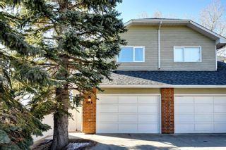 Photo 1: 31 Stradwick Place SW in Calgary: Strathcona Park Semi Detached for sale : MLS®# A1119381