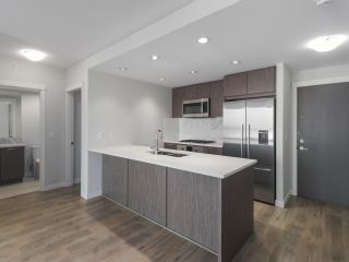 """Photo 2: 906 3281 E KENT NORTH Avenue in Vancouver: South Marine Condo for sale in """"RHYTHM BY POLYGON"""" (Vancouver East)  : MLS®# R2447202"""