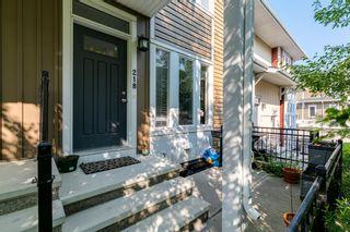 Photo 2: 218 Auburn Bay Square SE in Calgary: Auburn Bay Row/Townhouse for sale : MLS®# A1141951