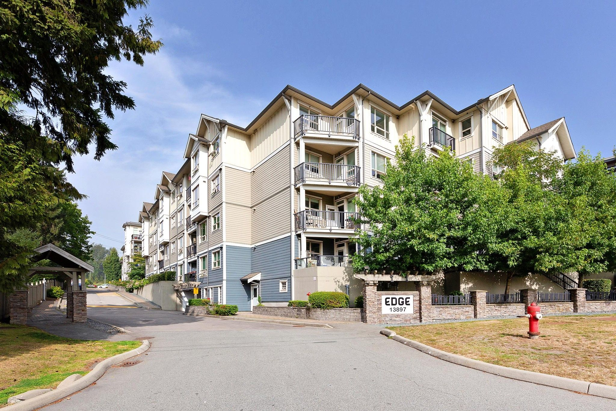 "Main Photo: 326 13897 FRASER Highway in Surrey: Whalley Condo for sale in ""THE EDGE"" (North Surrey)  : MLS®# R2499236"