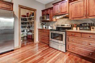 Photo 10: 106 Gleneagles Landing: Cochrane Detached for sale : MLS®# A1130993