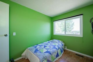Photo 35: 332 Queenston Heights SE in Calgary: Queensland Row/Townhouse for sale : MLS®# A1114442