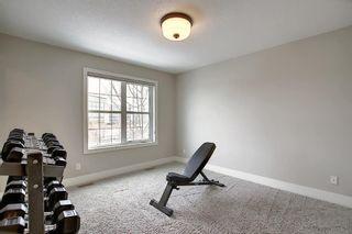 Photo 15: 374 Quarry Park Boulevard SE in Calgary: Douglasdale/Glen Row/Townhouse for sale : MLS®# A1063797