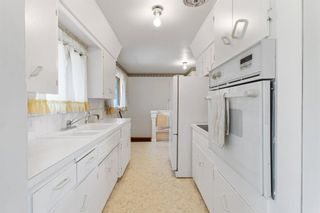 Photo 12: 2328 58 Avenue SW in Calgary: North Glenmore Park Detached for sale : MLS®# A1130448