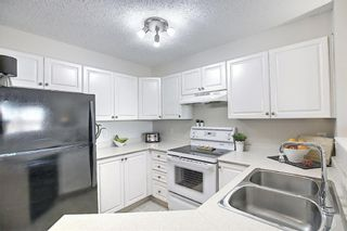 Photo 1: 3212 604 8 Street SW: Airdrie Apartment for sale : MLS®# A1090044