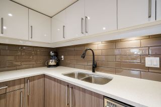 """Photo 4: 102 1450 PENNYFARTHING Drive in Vancouver: False Creek Condo for sale in """"HARBOUR COVE"""" (Vancouver West)  : MLS®# R2560607"""