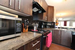 Photo 4: 602 2445 KINGSLAND Road SE: Airdrie Townhouse for sale : MLS®# C3624049