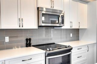 Photo 9: 971 Nolan Hill Boulevard NW in Calgary: Nolan Hill Row/Townhouse for sale : MLS®# A1114155