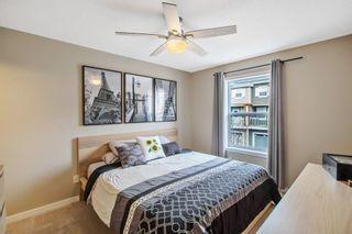 Photo 12: 1204 10 AUBURN BAY Avenue SE in Calgary: Auburn Bay Row/Townhouse for sale : MLS®# A1065411