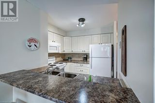 Photo 11: 150 DUNLOP Street E Unit# 703 in Barrie: House for sale